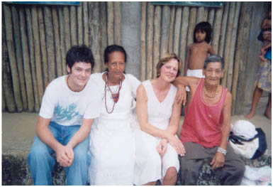 In 2005 Elizabeth is seated next to the cacique, the chief of a Guarani village, with her son and Niara, another shaman from a neighboring tribe.